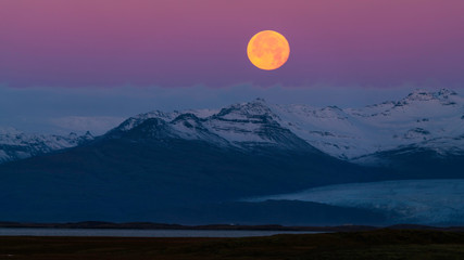 Beautiful landscape at Stokksnes, a moonset in the colors of sunrise
