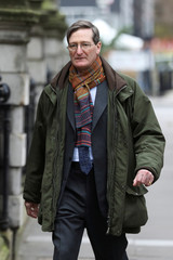 Former Attorney General Dominic Grieve looks out as he walks near the Houses of Parliament in Westminster in London