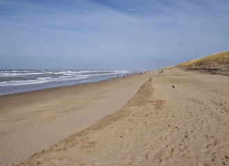 view down the beach of Katwijk with distant people