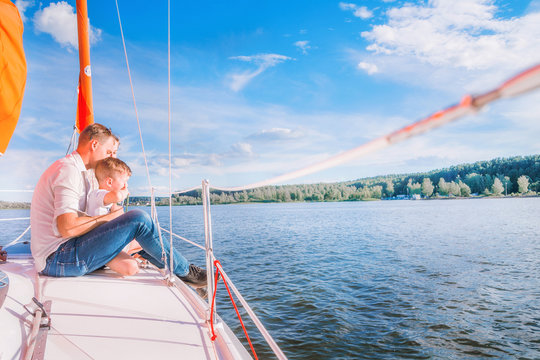 happy family on a yacht trip. Horizontal photo