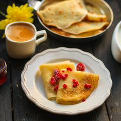 pancakes crepes fritters with raspberry berries (pancakes with filling) Shrovetide. food background. top view