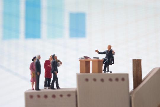 Miniature people : lawyer or financial advisor insurance broker or bank worker