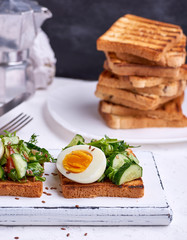 toasted square pieces of bread from white wheat flour with boiled egg