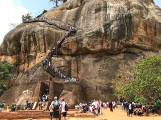 People Climbing up Sigiriya Rock in Sri Lanka