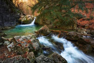 Beautiful view of Yew waterfall, waterfall in mountains in autumn, Grand Crimean Canyon, Crimea