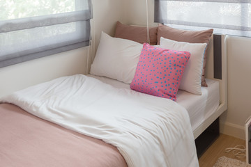 modern single bed in modern bedroom