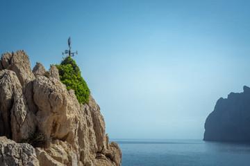 Weathervane on a Rocky Cliff on the Coast of Mallorca