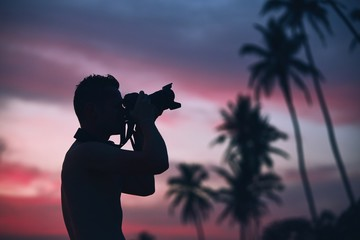 Silhouette of the photographer at sunset