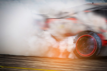 Blurred Race car drifting on speed track on twilight background.