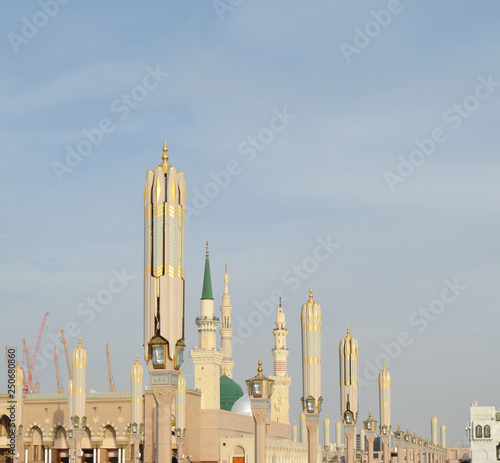 xterior view of minarets and green dome of a mosque taken