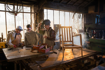 Two craftsmen and their apprentices in their craft workshops