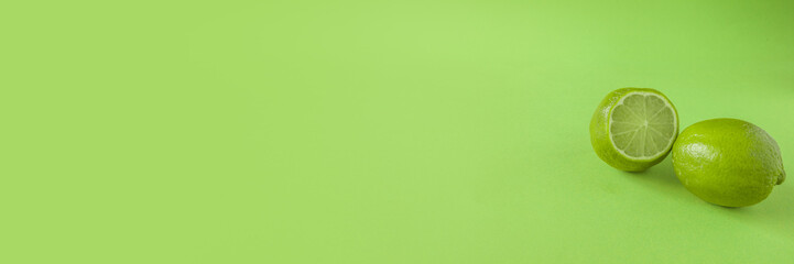 Perfect Fresh Green lime fruit Isolated on green Background Full Depth of Field Banner