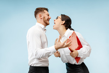Angry boss. Woman and his secretary standing at office or studio. Businesswoman screaming to his colleague. Female and male caucasian models. Office relationships concept, Human emotions