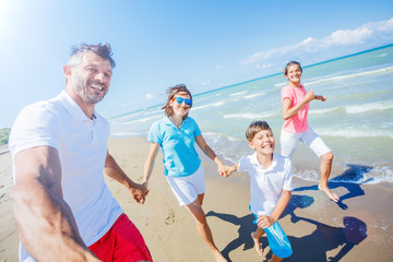 Happy family having fun at beach together. Fun happy lifestyle in the summer leisure