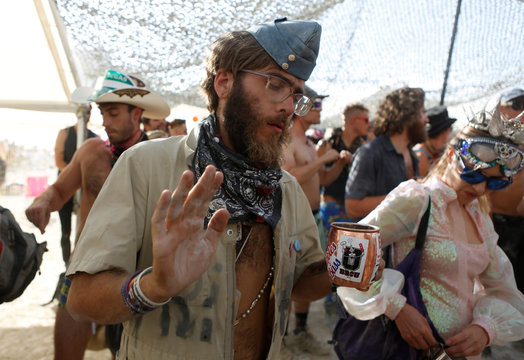 Jonny Moderation dances as approximately 70,000 people from all over the world gathered for the annual Burning Man arts and music festival in the Black Rock Desert of Nevada
