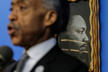 A picture of Martin Luther King Jr. is seen on the wall as Rev. Sharpton speaks to guests during the National Action Network Dr. Martin Luther King, Jr. Day Public Policy Forum in the Harlem borough of New York City