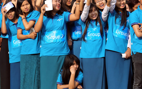 People stand as they participate during an official attempt to break Guinness  World Record  with 3400 people in making giant human map of Myanmar organized by Telenor, in Magway