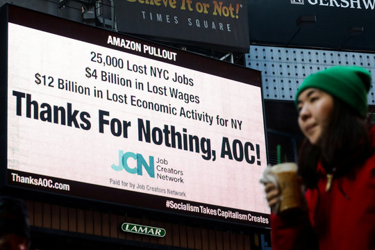 Times Square billboard displays statement about U.S. Rep. Ocasio-Cortez and the Amazon pullout in New York City