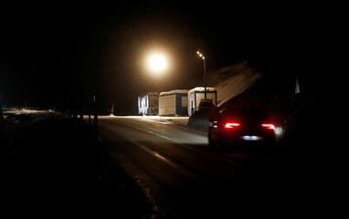 Car drives past military checkpoint which will be used for the upcoming WEF near Davos