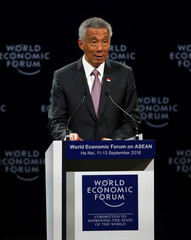 Singapore's Prime Minister Lee Hsien Loong speaks at the plenary session of the World Economic Forum on ASEAN at the Convention Center in Hanoi