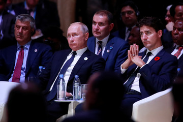 Hashim Thaci, President of Kosovo, Russian President Vladimir Putin and Canadian Prime Minister Justin Trudeau attend the opening session of the Paris Peace Forum