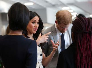 Britain's Prince Harry and his fiancee Meghan Markle attend a reception with delegates from the Commonwealth Youth Forum at the Queen Elizabeth II Conference Centre, London,