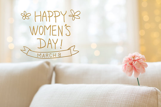 Women's Day message with a flower in a bright interior room sofa