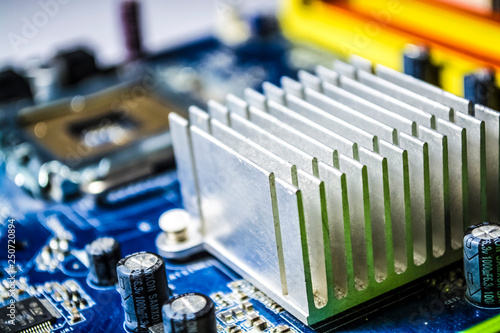 The blue motherboard and details, old and with dust from the