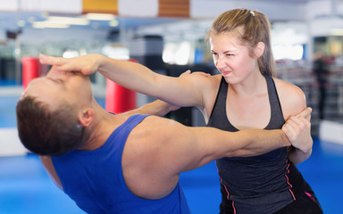 Fitness woman and her trainer are exercise punches