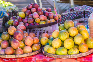 Organic Passion fruit (Passiflora edulis) for sale at the local market in Thailand. Passiflora edulis also known as passion fruit or passionfruit, maracuya or parcha, grenadille or fruit de la passion