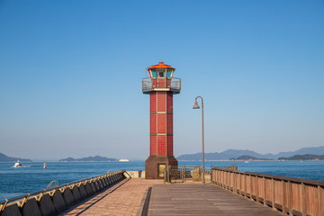 Red Lighthouse and Boats on the seto inland sea