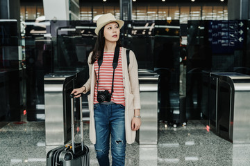 female tourist use e gate in Taiwan International Airport. main international hub for airlines. young local chinese woman going depart to foreign country self pass the passport reader new technology.