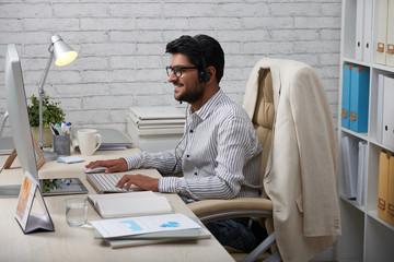 Happy businessman in headset