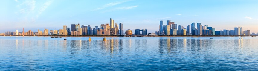 Panoramic city skyline with buildings in Hangzhou at sunrise