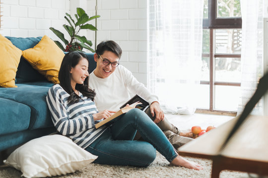 Lifestyle Asian couple man and woman talking working  spend time together at home, Asian couple family lifestyle concept