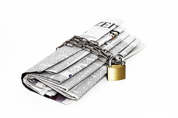 Newspaper chained with padlock