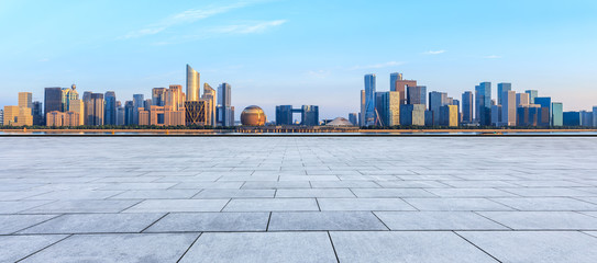Empty square floor and Hangzhou city skyline with buildings