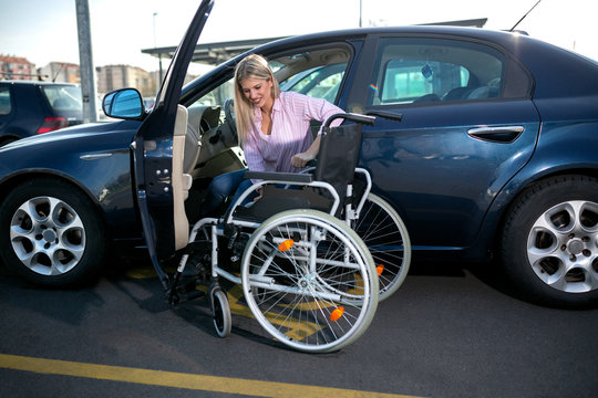 Blonde girl with loss of leg function sitting in the car