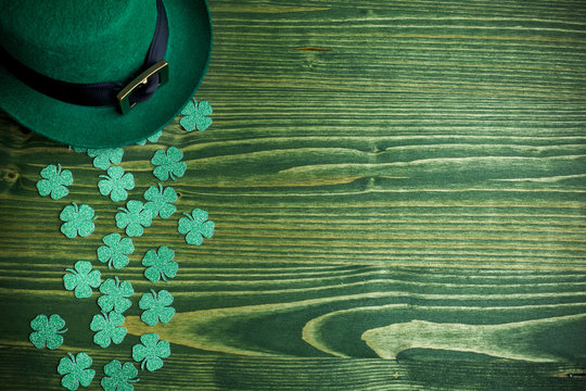 lucky green hat for st. patricks day on green wood background