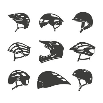 Monochrome vector illustration of a set bicycle helmets, isolated on a white background.