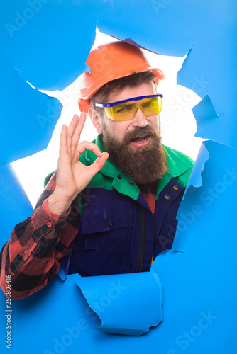 11202ee0d2a Builder in hard hat shows sign ok. Mechanical worker making gesture okay.  Construction worker