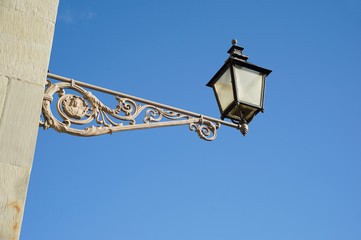 vintage street lamp on a house in Stockholm Sweden