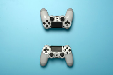 Two gamepad controller joystick on blue pastel background