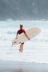 Female surfer at the beach