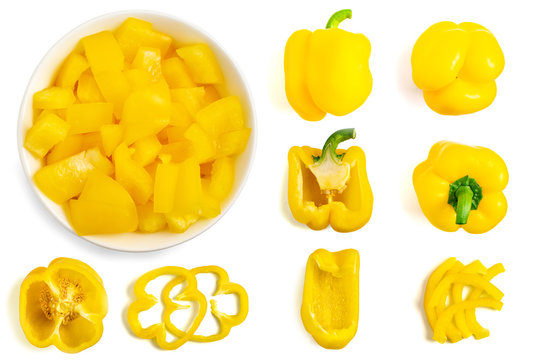 Set of fresh whole and sliced yellow bell pepper isolated on white background. Top view