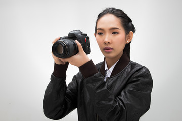 Photographer hold camera with lens point to shoot subject, wear normal dark black leater suit jacket. studio lighting white gradient grey background isolated, reporter journalist take photo celebrity