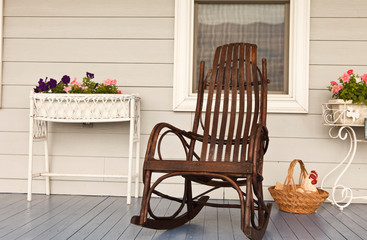 Rocking Chair on Front Porch of a Farm House