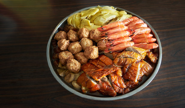 Chinese new year traditional food , big bowl feast together with chicken, duck, fish, yuba, radish, shiitake, pork,prawn,abalone . Meaning reunion and rich .