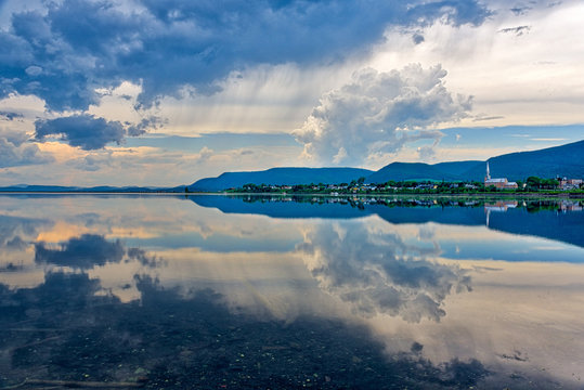 A dramatic sky perfectly reflected in the lagoon at Carleton in Gaspesie, Quebec