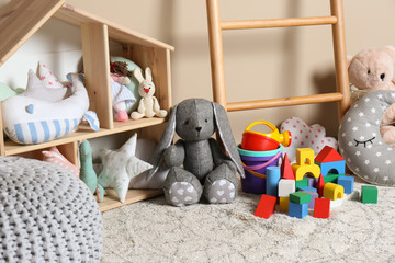 Different child toys on floor against color wall Wall mural